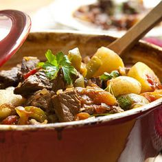 Meat and potatoes guys cheer for this hefty, fragrant stew that also includes healthy servings of tomatoes and other vegetables.