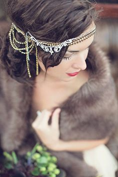 A jeweled headpiece and fur stole adds a vintage look to this beautiful #bride.