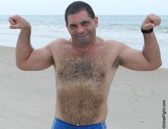 a daddiebears cub flexing ocean beach lake