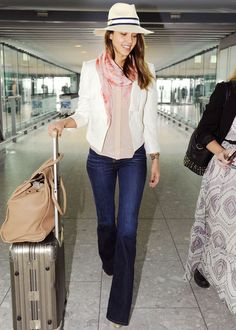 Yes, there is life beyond skinny jeans! Jessica Alba earns her chic frequent-flyer miles in supremely flattering dark-wash flared jeans by J Brand.