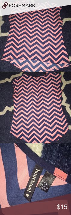 Pink and Navy patterned blouse, size medium Navy and pink patterned blouse, good condition, no stains or holes, size Medium and high low effect Tops Blouses