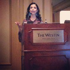 Dr. Gisele Oliveira giving a presentation at #SYMP2013