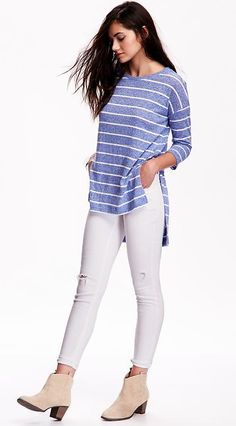 We don't know what we adore more about this blue and white striped slub knit hi-lo tee t-shirt: the cut, or the comfort. Simple, stylish, and versatile, we love how this shirt look paired with solid-color jeans and chunky short ankle boots.