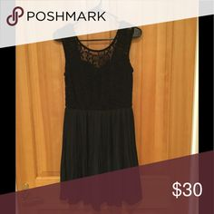 Black dress In great condition. Goes to my knees I'm 5'9 boutique Dresses Mini