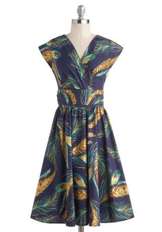 pretty feather dress with a flattering cut.