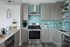 Modern kitchen design with minimalist slab door cabinets in med-grayfinish and aqua/teal tiled back-splash. [1500x1000] [OC]