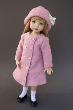 A chill is in the air and its time to bundle up your Little Darlings! Top off your precious girl in this cozy, double breasted coat set. Sewn out of an elegant dusty pink boiled wool-type fabric, this unlined coat is generously sized to fit over some of her favorite outfits (but perhaps not the bulkiest sweaters). Two rows of buttons march down the front while tiny snaps actually close the front from brisk autumn breezes. A sweet cloche style hat with hand-tinted felt flowers completes the…