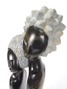 Lovers in Passion   Shona Sculpture from Zimbabwe. $2400.00 This gorgeous one of a kind sculpture was skillfully crafted by Rufaro Ngoma, depicting a couple in loving embrace. It's carved from springstone, a very hard type of serpentine. A beautiful dark stone, it polishes to a high shine because of it's density.