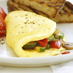 Fresh Vegetable Omelet: An Egg Beaters omelet recipe filled with fresh zucchini, red bell pepper and mushrooms flavored with Italian seasoning