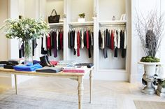 Joie Boutique Interior - Like design elements...moss, twigs, clean lines