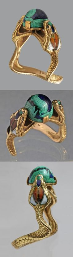 A Symbolist Serpent Ring, CHARLES BOUTET DE MONVEL, French, circa 1900. The Hooded Cobras clutching a blue green cabochon 'world', gold, enamel, lapis and malachite. Marks: Signed 'B. de Monvel', French, c.1900. #Symbolist #DeMonvel #ring