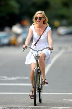 Kirsten Dunst knows an airy white dress is the perfect piece for an afternoon bike ride.