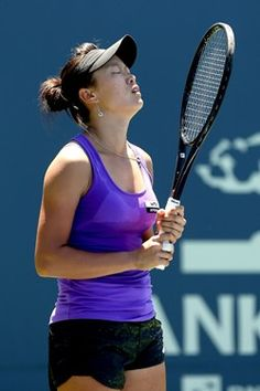 Kai-Chen Chang of Taiwan reacts to a lost point while playing Yanina Wickmayer of Belgium during the Bank of the West Classic at Stanford University Taube Family Tennis Stadium on July 9, 2012 in Stanford, California.