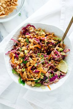 This Thai-flavored salad recipe is made with carrots, cabbage, snow peas, and quinoa, tossed in peanut sauce. Vegan, gluten free, and packs well for lunch.