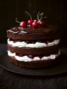 Black Forest gâteau and Black Forest cake are the English names for the German dessert Schwarzwälder Kirschtorte.   Typically, Black Forest cake consists of several layers of chocolate cake, with whipped cream and cherries between each layer. Then the cake is decorated with additional whipped cream, maraschino cherries (sometimes sour cherries), and chocolate shavings.  Traditionally, Kirschwasser (a clear tart cherry liquor) is added to the cake.