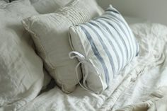 How to Sew Farmhouse Pillow Covers - using IKEA Elly dish towels and bias tape.  These are cute covers - via Farmhouse on Boone
