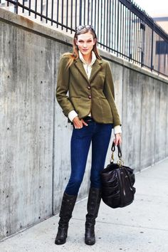 Green Blazer, Blue Jeans, And Black Boots And Purse