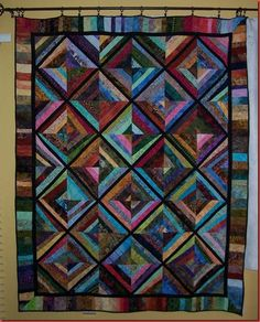 Bonnie Hunter..just love the deep jewel tones in this quilt!