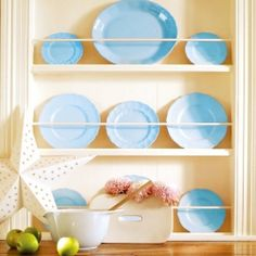 Use leftover boards to make a slimline rack to display pretty dinner plates.