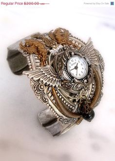 Gothic Steampunk Watch Cuff   Valkyries and by LeBoudoirNoir, $180.00