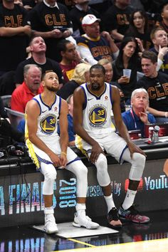 2a491a69be8 Kevin Durant and Stephen Curry of the Golden State Warriors wait to check  in against the