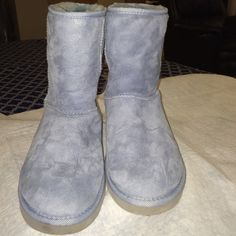 Authentic Ugg Boots Size 9 Authentic Cornflower/Periwinkle Ugg Boots. Pre-Owned. Great Condition. Size 9. Such a great color. So comfortable!  Mid- Calf. Classic UGG Shoes Ankle Boots & Booties