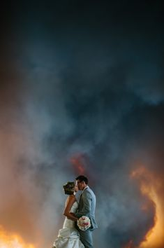 Wedding pictures with Bend OR wildfire as the backdrop.  The fire dept arrived just as the bride was walking down the aisle, so the firemen allowed them to have the ceremony.