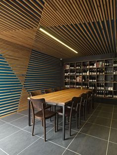 Suspended wood panel ceiling design for wine bars. #unique #neat #contemporary…