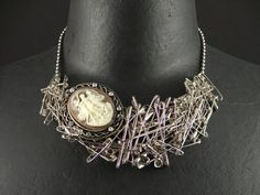 http://www.realmbyjessewalker.com/18988/index.htm?purchase=229591 Safety pin necklace $138