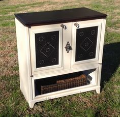 This 40s Philco Music Console has received a new life as a great storage center. Cabinet was painted with Dixie Belle Paint mineral paint in Drop Cloth. The doors were decorated with punched tin pie safe panels. A perfectly repurposed piece from Just Repurposed
