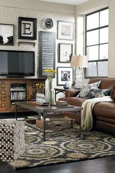 Cozy Living Room Decorating Ideas - like how the pictures are around the tv Would love to see the whole wall. Cozy Living Rooms, Home Living Room, Apartment Living, Living Room Furniture, Living Room Designs, Barn Living, Cozy Apartment, Living Room Decor Brown Couch, Rustic Apartment
