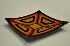 """Decorative handmade plate """"Emma"""" performed by myself in my glass workshop. Plate was done from Baoli fusable glass in the glass kiln.  It has practical but decorative form combining several colours and shapes. Combine mosaic of stacked shapes in yellow, red and black colours."""