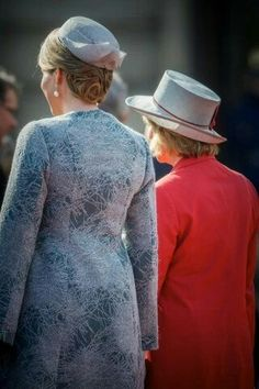 A Back View Of Mathilde & Daniela 's Outfits When The German President & His Partner Arrived In Brussels, Belgium.