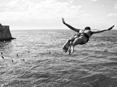 A man dives into the sea on La Caleta Beach in Cádiz, Spain, in this National Geographic Photo of the Day. Tide is high. Photograph by Fran Virues Avila, National Geographic Your Shot