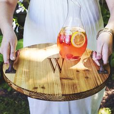 Serve anything from drinks to appetizers on our Personalized Rustic Wooden Tray. Crafted from fir wood, this wooden serving tray features an accent of two metal handles for easy carrying, a rounded st