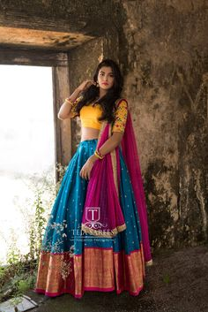 Beautiful blue color designer lehenga and blouse with parrot green color net dupatta. Blouse with hand embroidery work and lehenga with swirls at the bottom. Half Saree Lehenga, Lehenga Style, Saree Dress, Anarkali, Lehenga Blouse, Half Saree Designs, Lehenga Designs, Blouse Designs, Dress Designs