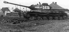 """Soviet heavy tank JS-2 (Joseph Stalin), captured by the Germans. On the tower inscription in German: """"Intended for OKW - """" (OKW - High Command of the Wehrmacht). The first tank JS-2 (probably just that) the Germans invaded in May 1, 1944. This JS-2 was damaged by self-propelled tank destroyers. Hauled out of the damaged JS-2 – tanks """"Tiger"""". Trophy transported to the landfill in Kummersdorf."""