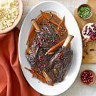 Try the Pomegranate-Merlot Braised Lamb Shanks Recipe on williams-sonoma.com/