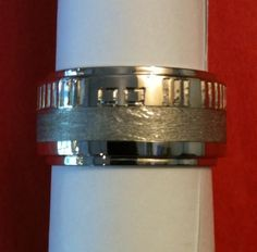 Complex custom crafted extra wide Meteorite lined in white gold with external surface hand-engraving of wedding date in binary code. Extremely difficult undertaking that took 4 months to perfect. Gibeon Meteorite, Gents Ring, Ring Crafts, 4 Months, Hand Engraving, Rings For Men, Surface, White Gold, Wedding Rings