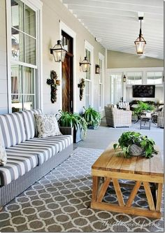 Front porch with white wicker and red accents. Description from pinterest.com. I searched for this on bing.com/images