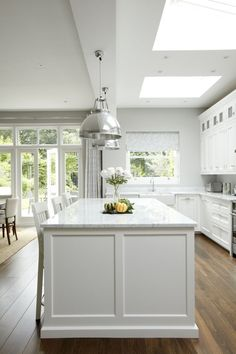Though I'll always love a white kitchen, the grey and white kitchen look right now is really speaking to me! These gorgeous examples will inspire you too!