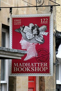 Bookstore sign with stamp look -- Madhatter Bookshop - Burford; Oxfordshire, England