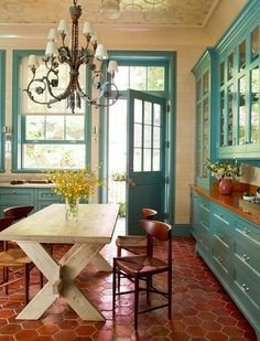 Beautiful Turquoise Cabinetry and Trim in Kitchen with Eat-In Space