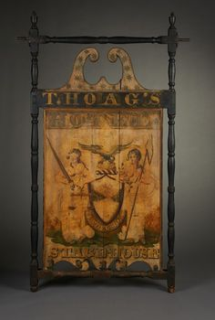 """Dimensions: 67"""" x 42""""  Date / Circa: c. 1800-10  Maker / Origin: Artist unknown Chatham (formerly Federal Stores), New York  Medium: Carved, turned and painted wood and iron. Retaining the original polychrome decorated finish depicting the New York State Seal with areas of early 19th c. re-paint."""