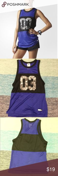 NWOT Adidas Floral Mesh Jersey Muscle Tank NEW! Without Tags. Cute and Sporty Adidas Adigirl Streetwear royal blue with hints of purple and black mesh 03 grey floral muscle tank top. Size is a small. Seen on Zendaya in last pic. Comment if you have any questions. 😊 adidas Tops Tank Tops