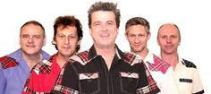 """The Bay City Rollers were worldwide teen idols. The classic line-up included Eric Faulker, Stuart John Wood. Les McKeown, Alan Longmuir and Derek Longmuir.  The band's first hit was """"Keep on Dancing"""". This song was a huge success and they then went on too making appearances on BBC One's Top of the Pops."""