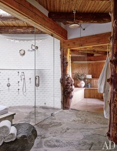 The gym's spa features a tiled shower with local flagstone pavers and a sauna lined in white cedar.