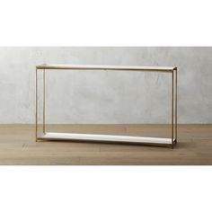 Shop cleo console table.   Glossy white enamel, shiny brass and classic box construction—the definition of luxe minimalism.  Inset top and bottom shelves double the storage space of a traditional console.
