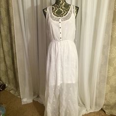 White beach maxi dress Brand new maxi dress that is sheer. The white undercover can be removed so only the clear maxi dress can be used with a bathing suit underneath Dresses
