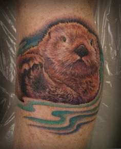 Google Image Result for http://bushwarriors.files.wordpress.com/2010/12/sea-otter-tattoo-by-hayley-lakeman.jpg